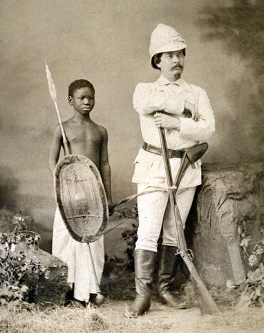 "Henry Morton Stanley (of ""Dr. Livingstone, I presume"" fame) poses with Kalulu, a boy who became Stanley's servant and adopted son on his journeys. Kalulu traveled to Europe with Stanley and became a..."