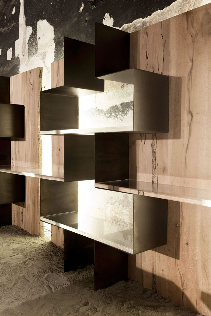 The Teredo line is made up of a desk and a bookcase-cabinet, both made of bent metal sheets and shaped panels made up of brushed oak slats. The bookshelf has been conceived in a modular structure where the base module comes in a separate and autonomous structure, available both in RH and LH versions. The combination of modules and use of methacrylate shelving contribute to create more complex structures through their interactions.  www.officinamarocchi.it