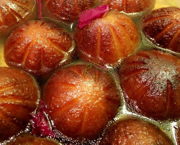 """""""A deep fried mouth melting mawa balls shaped like a modak served in rose flavored sugar syrup"""""""