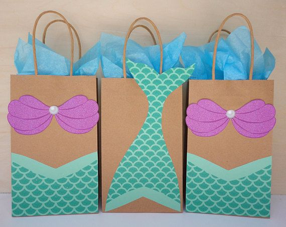**This Listing is for a PRINTABLE - INSTANT DOWNLOAD File to make your own Mermaid Favor Bags** (Please note: There are some elements that are designed to look like glitter, but no actual glitter will be printed on these templates)  Add a special touch to your Mermaid Party with these adorable Favor Bags designs!! Simply: Print, Cut and Glue them onto the favor bags. You may print as many times as you need! ** Use on suggested Bag Size: Approx. 5.25W x 8.25H  * Whats included in this order…