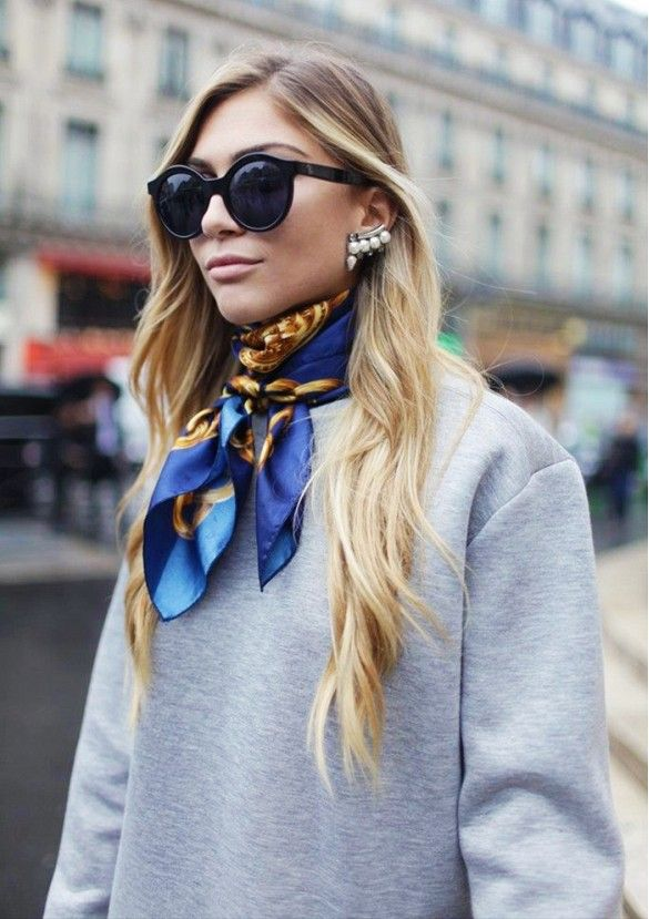 Pair a silk scarf with oversized sunglasses and a modern ear cuff for an edgy-glam look
