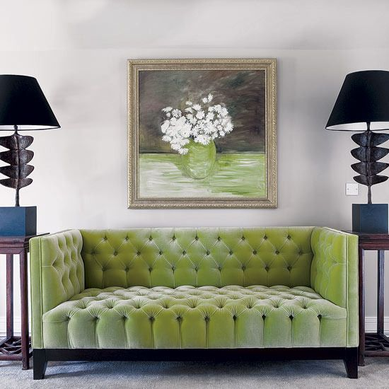 living room apple green tufted sofa with two artistic modern black light fixtures flanking the. Black Bedroom Furniture Sets. Home Design Ideas