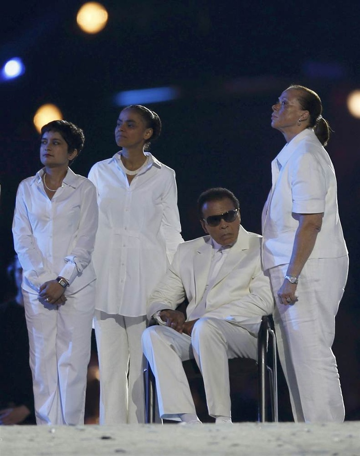 Boxing legend Muhammad Ali, seated, takes part in the Opening Ceremony of the London 2012 Olympic Games at the Olympic Stadium. (Photo: Mike Segar / Reuters)
