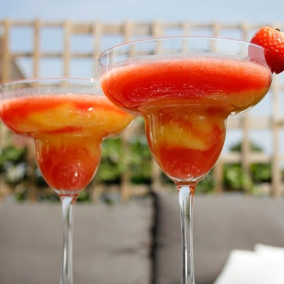 Strawberry and mango daiquiri.Rum based alcoholic mixed drink.Very easy to prepare.