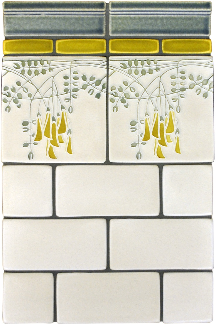 This golden liner really makes the delicate flowers in our Flora tile pop;Uses 2x6 Rothwell trim in Rothwell Gray, 1x3 field tiles in Golden, 6x6 Flora polychrome tiles in Gray, 3x6 field tiles in Cream, and 3x3 field tiles in Cream. www.motawi.com