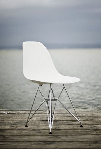 Eames white moulded plastic shell and wire base