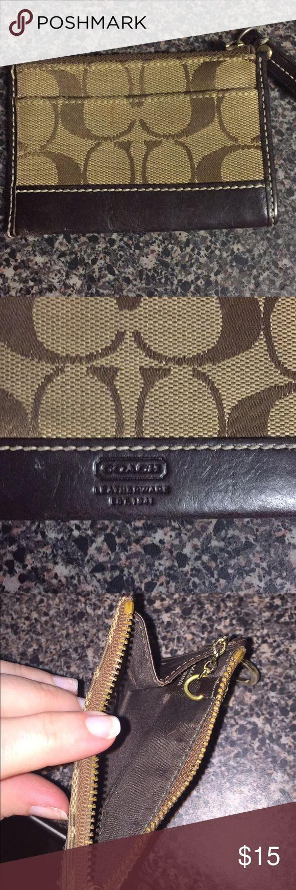 Coach original skinny wallet Coach original print skinny mini. Has a small mark on front (see photo) otherwise in good condition. Coach Bags Clutches & Wristlets