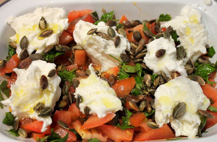 Tomato and caper salad with mozzarella and pumpkin seeds
