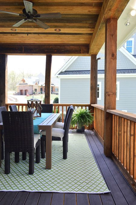 Outdoor rug & table for the showhouse's back deck (wood ceiling, represent)