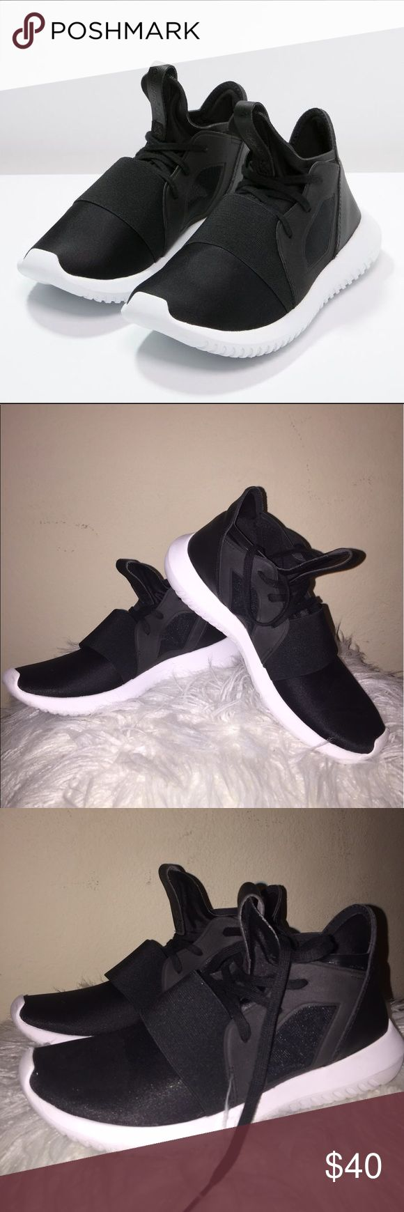 Adidas Tubular High Top Black Size 7 Women Adidas Kendal Jenner's Sneaker (Black version) || Super trendy and casual :)) In great condition only wore once or twice!! It is size 6.5 but fit like a 7 :))                                                               If you have any questions or request (lower the price, more pictures,..) please let me know :)) - I do accept reasonable offers so please feel free to let me know to get discounted - Fast Shipping + Good service - Smoke and Pet free…