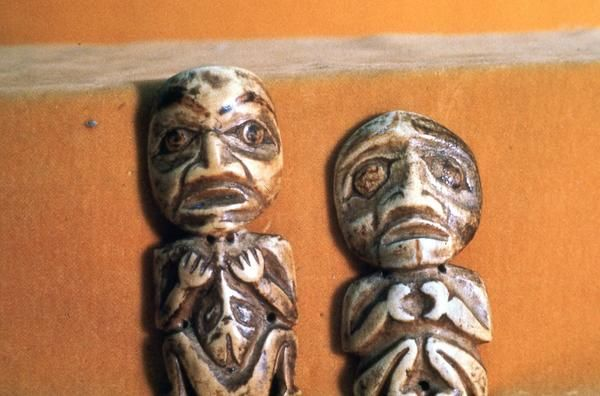 Carved bone amulets, in shape of humanoids.