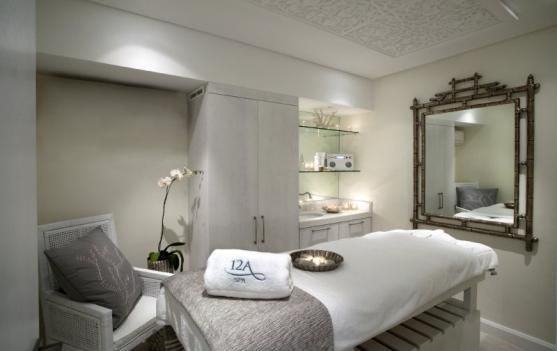 Bright neutral co lors,lights,mirror,massage table and equipment,everything in place!http://www.blasononline.com/portal/spa-equipment/massage-facial-wax-beds