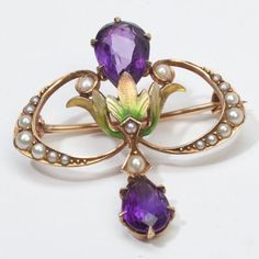 A truly superb Art Nouveau era Brooch (circa 1900s to 1910s), crafted beautifully in 14k yellow Gold. Made by KREMENTZ, the mount features a colorful Enamel display with shimmering royal purple Amethysts adding rich color. A fine quality, beautifully made piece in very good condition. A delightful all original Art Nouveau era piece (not reproduction) that would make a wonderful addition to your fine antique jewelry collection... Weight: 3.4 grams