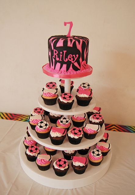 pink and black zebra print cupcake tower with soccer and cheer cupcakes by Simply Sweets, via Flickr