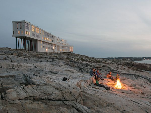 Picture of people around a fire outside the Fogo Island Inn, Fogo Island, Newfoundland, Canada