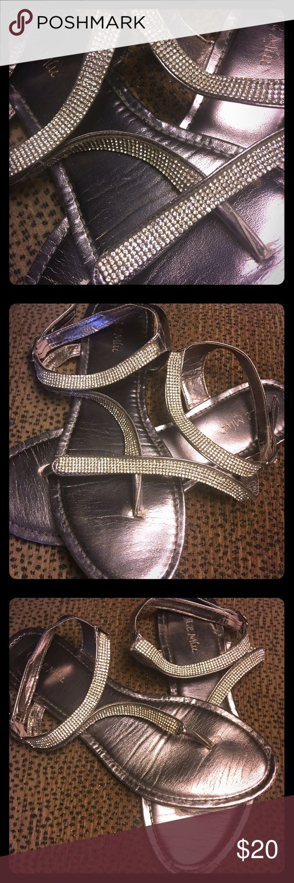 🌟 Sparkle Shiny Silver Sandals GOOD CONDITION• OFFERS WELCOME• Adorable shiny silver flat sandals w sparkles / shiny stone straps w buckle. Minor wear n tear. Refer to pics. All stones in tact. Wore them in my besties outdoor wedding. Still TONS of life in these gorgeous sandals. Size 8.5 Shoes Sandals