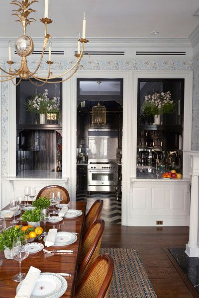Home Tour: An Elegant Brooklyn Townhouse for the Ages—The designers incorporated internal windows in the kitchen to help define the space while maintaining a sense of flow with the adjacent dining room. Extended marble sills create informal bar areas, where Wight's children can eat a casual meal while she cooks.