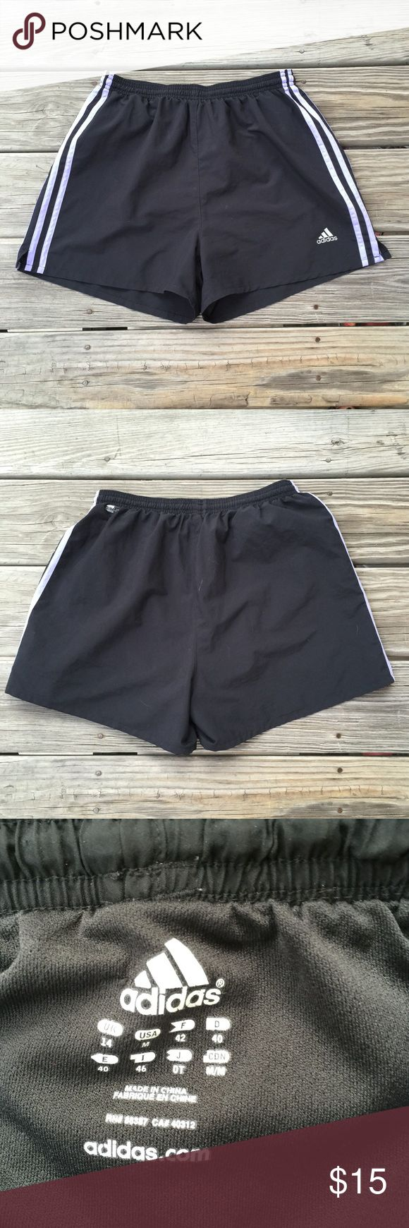adidas soccer shorts adidas soccer shorts— size medium. like new condition, gently worn. black with the iconic three stripes in a beautiful lilac color (: has an inner liner.   no flaws noted adidas Shorts