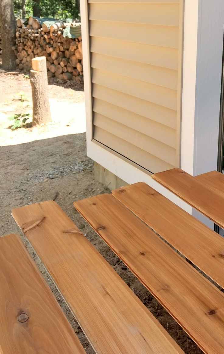 Cedar tongue and groove next to certainteed natural clay