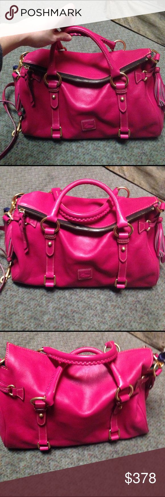 """Dooney & Bourke fuschia medium florentine satchel DOONEY & BOURKE Florentine Leather Satchel, Fuchsia. NEW, Leather,  Double handles with 4.5"""" drop; detachable, adjustable strap with 19"""" drop  Top zip closure  Gold-tone hardware throughout; double buckle detail and logo patch at front; fringe tassel at sides  Interior features two-tone lining, zip pocket, key keeper hook and 2 open pockets, 1 with snap  Dimensions: 15 inches x 6.5 inches x 9.5 inches (when top is folded over).  Please note…"""