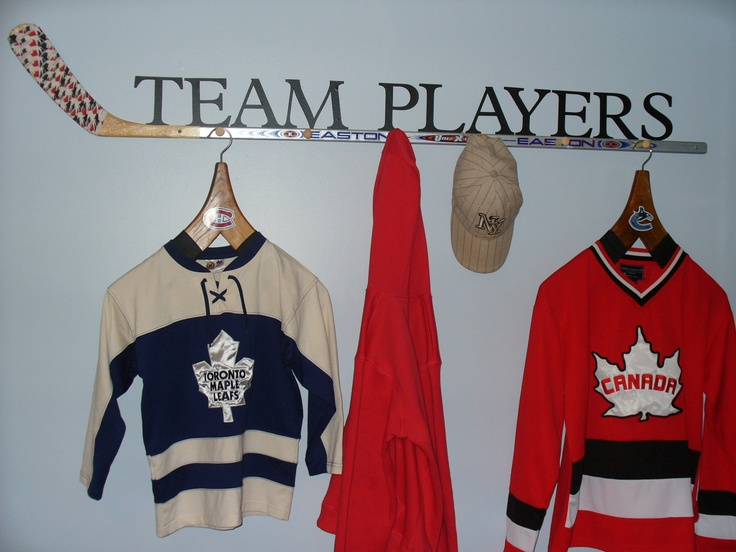Use a hockey stick and wooden pegs to create a cool hanger for your hats and jackets.This is the one that we made for my little boys room hockey theme bedroom.