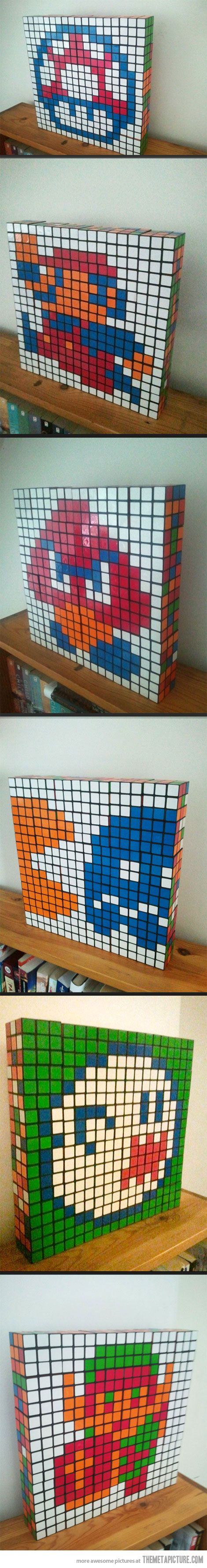 Rubik's Cubism. If I could manage to find a bunch of cubes for relatively cheap, I would totally do this!