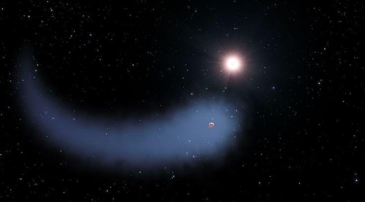 Illustration de GJ 436b et de son long nuage de gaz. Le rayonnement de l'étoile hôte (Gliese 436) décape lentement l'atmosphère de cette Neptune chaude située à seulement 30 années-lumière de nous. © Nasa, Esa, G. Bacon (STScI)