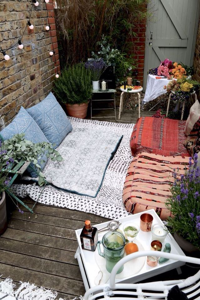 A Relaxed Outdoor Entertainment Space With Moroccan Floor Cushions