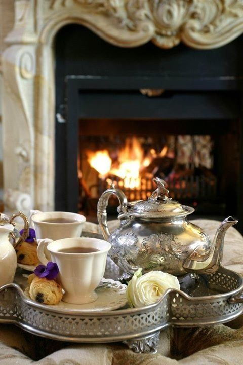 A hot cup of tea in a winter evening.