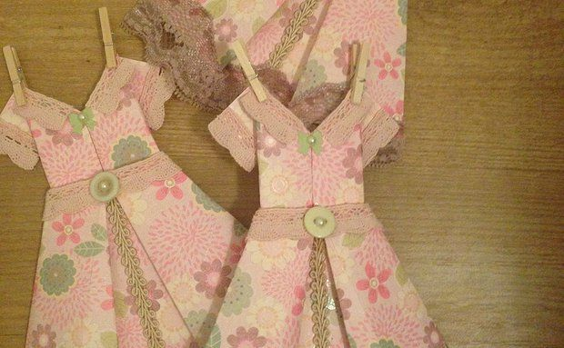 The 'Penny' Can purchase on Etsy Handmade origami dresses - great gifts sold as individuals and in packages, come with rustic twine, miniature pegs for hanging and decoupaged self-adhesive pegs to mount 'clothesline' for display