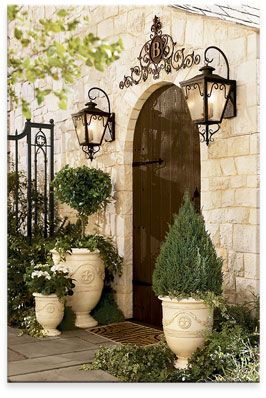 Master ensuite door. Love the lights and natural stone color. Planters. Everything.