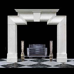 11831: A LARGE ART DECO BOLECTION CHIMNEYPIECE IN WHITE STATUARY MARBLE, the simply moulded shelf seated over the stepped bolection, the frieze of which is centered by a keystone. With restorations. English
