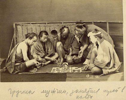 Japanese men playing a game or gambling. Meiji.