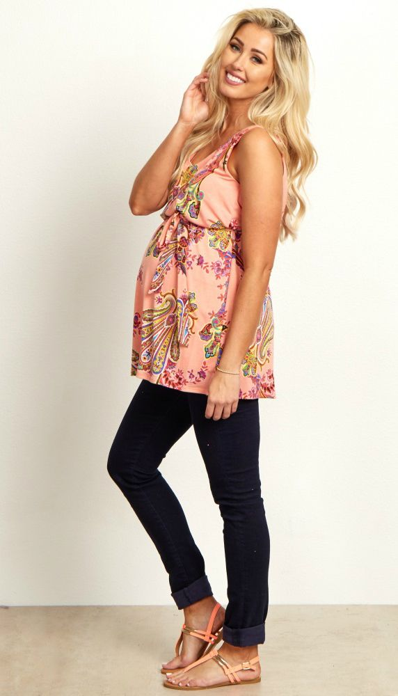 This maternity top will add that gorgeous splash of color your wardrobe needs. A v-neckline and sash tie detail with a paisley print will beautifully show off your bump this year. A pretty draped back is what really sets this maternity top apart from the rest. Style this maternity top with maternity jeans and boots for a complete look.