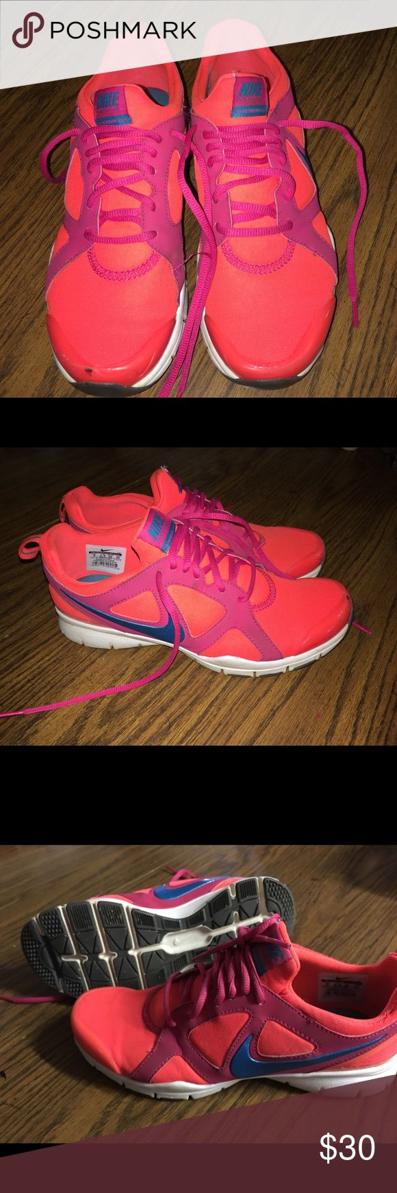 Women's Nike shoes size 8 Orange/ pink with a blue swish! Running shoes, in good condition. No rips! One mark from running on the front! Basic wear from running! Nike Shoes Athletic Shoes