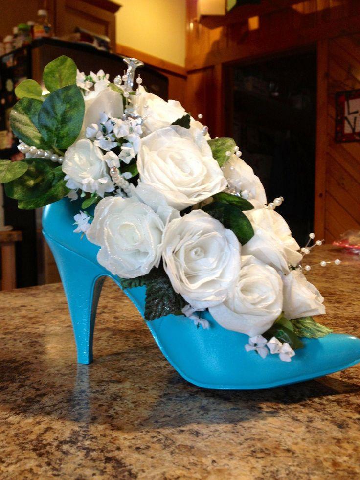High heel floral arrangement with handmade flowers.For
