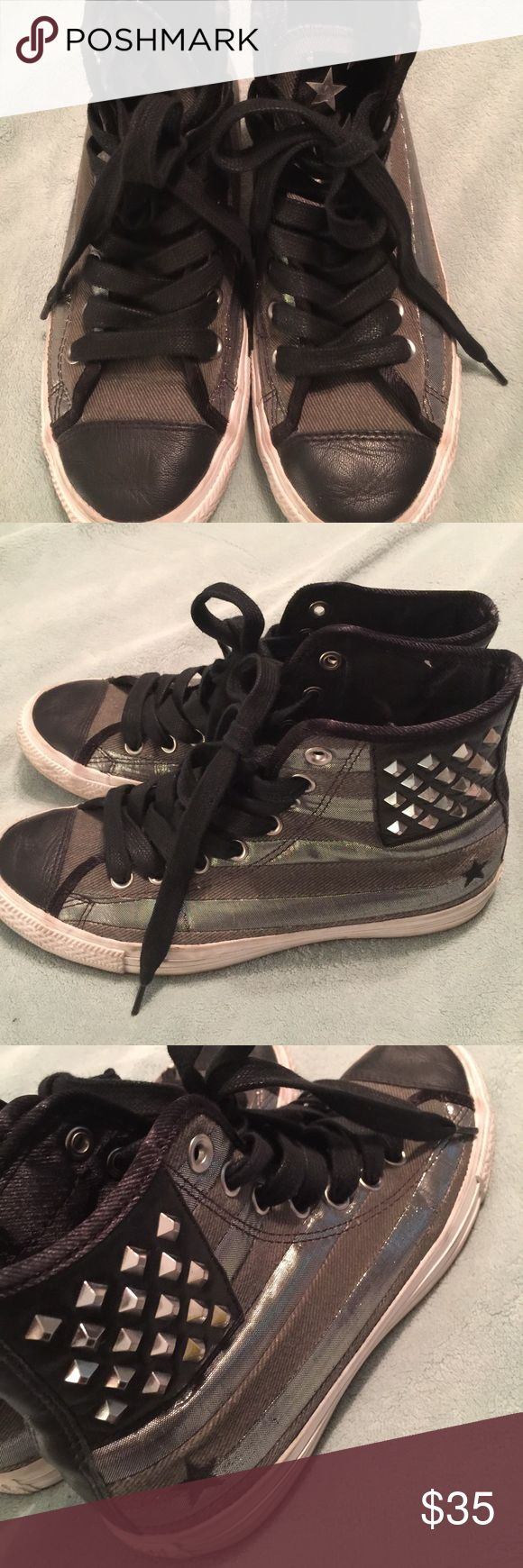 BLACK LEATHER HIGHTOP STUDDED CONVERSE ALL STARS Black leather converse with a gray shimmer along the sides. Shoe has a eye-catching studded design to make them more exciting to wear. Great used condition! Converse Shoes Sneakers