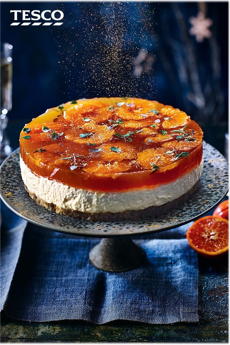 Looking for the ultimate Christmas dessert? This boozy mulled white wine cheesecake recipe is a real showstopper and has heaps of festive flavour from a fig roll and cinnamon base, creamy filling and sweet clementine and mulled wine jelly. | Tesco #cheesecake