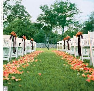 flower aisle or with rose petals scattered throughout. also like the flowers on each second row