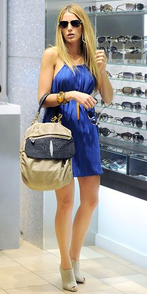 Blake Lively shopped in N.Y.C. rocking a cornflower blue sundress, a Khirma Eliazov bag, Louboutin booties and Tiffany & Co. aviators.