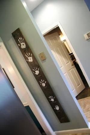 Handprint art. Budget friendly, and oh so cute! (wall color too) when we buy our house would love to do this with everyone's handprint by babyblu3