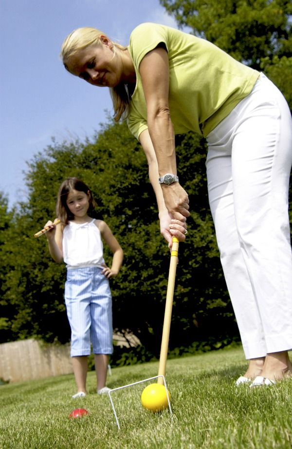 mother and daughter play croquet