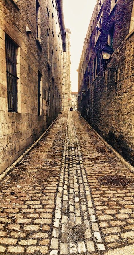 The cobblestoned streets of Old Montreal, Quebec, Canada / The cobblestones! Yes!  Uncomfortable under the feet; but so quaint & charming to see.