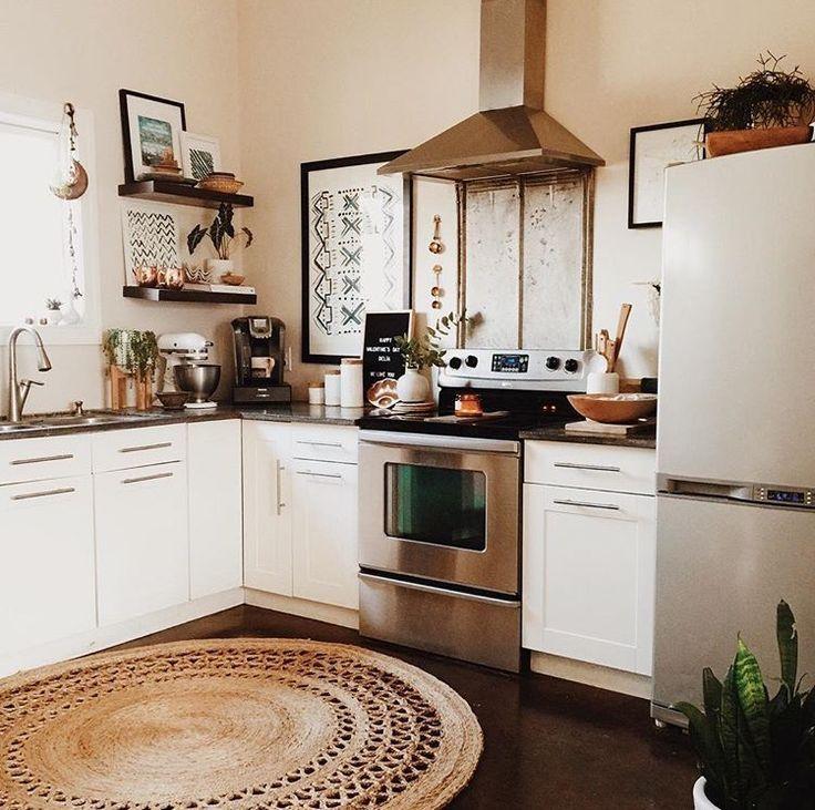 kitchen   white kitchen   stainless steel hood   round rug in kitchen   neutral color palette