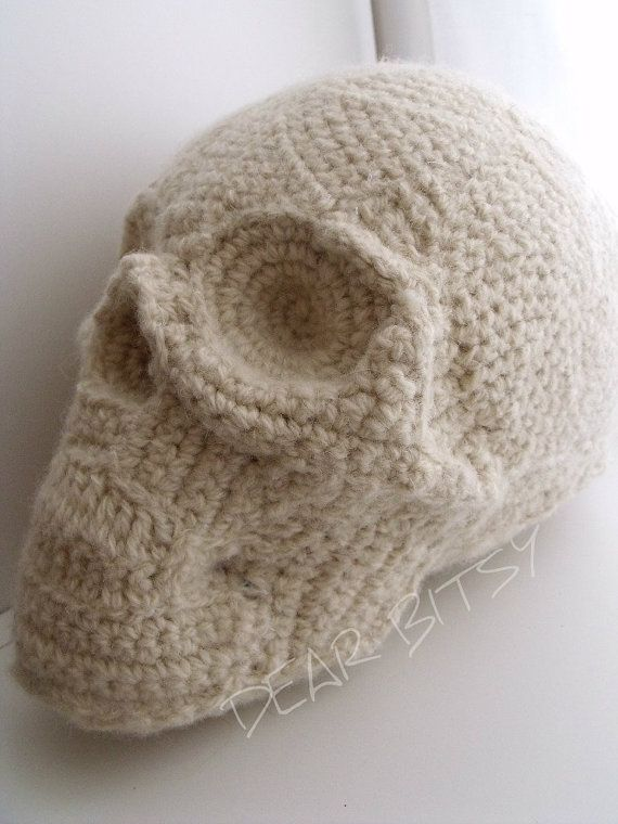 just when you think you've seen it all...then you get on etsy.  (Knitted skull pillow)
