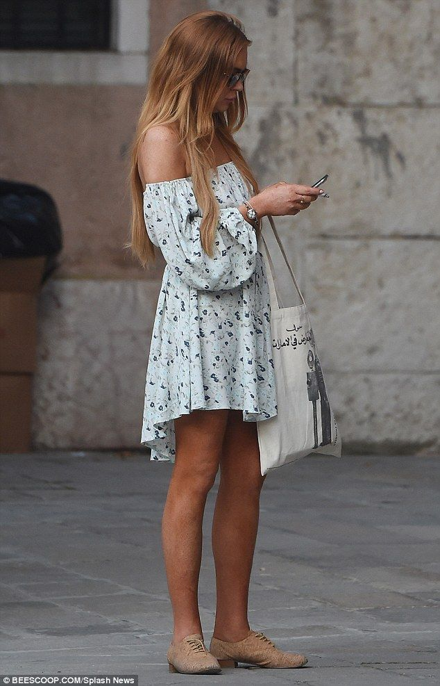 Lindsay Lohan smokes a cigarette before joining Mathia Milani in Italy   Daily Mail Online