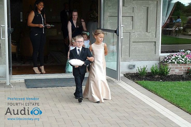 """The ringbearer and junior bridesmaid lead off the processional to """"Somewhere Over the Rainbow."""" http://www.discjockey.org/real-chicago-wedding-august-20-2016/"""