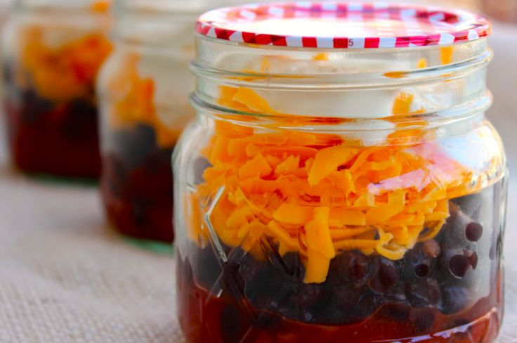 Skinny Burrito in a Jar  1 cup salsa, no sugar added 1 (15 ounce) can black beans, drained 1 cup reduced fat cheddar cheese, shredded