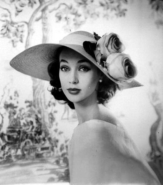 Large brimmed straw hat with roses in the Gainsborough style by Sally Victor, photo by Sharland, May 1956