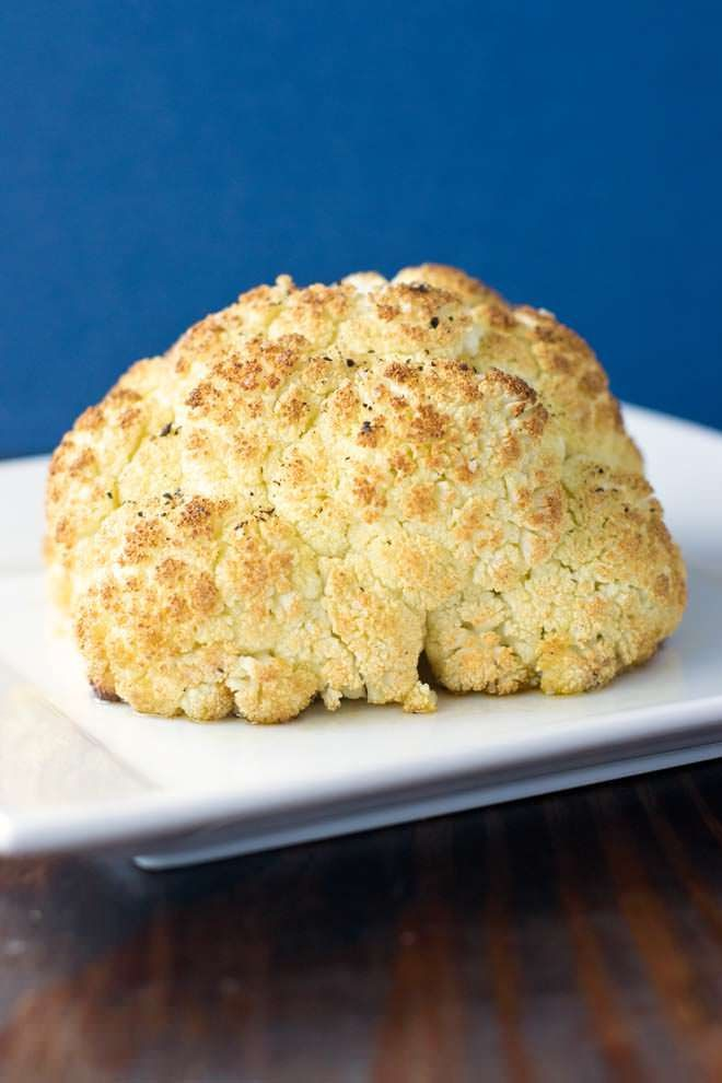 Whole Roasted Cauliflower Recipe - A how-to with photos on cleaning, preparing, roasting, and serving an entire head of cauliflower.
